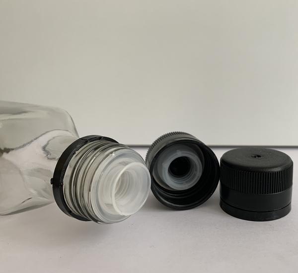 PP capsules met anti-lek plastiek zwart 100st